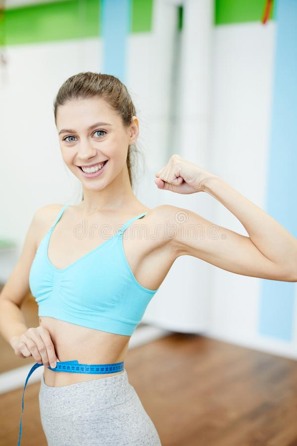 Woman Measuring Waist in Gym stock images