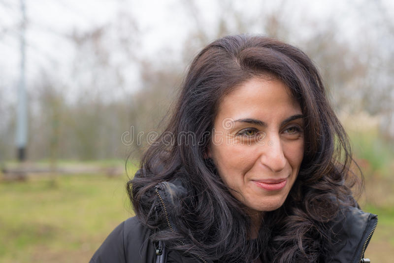 Portrait of smiling young woman, outdoors royalty free stock photography