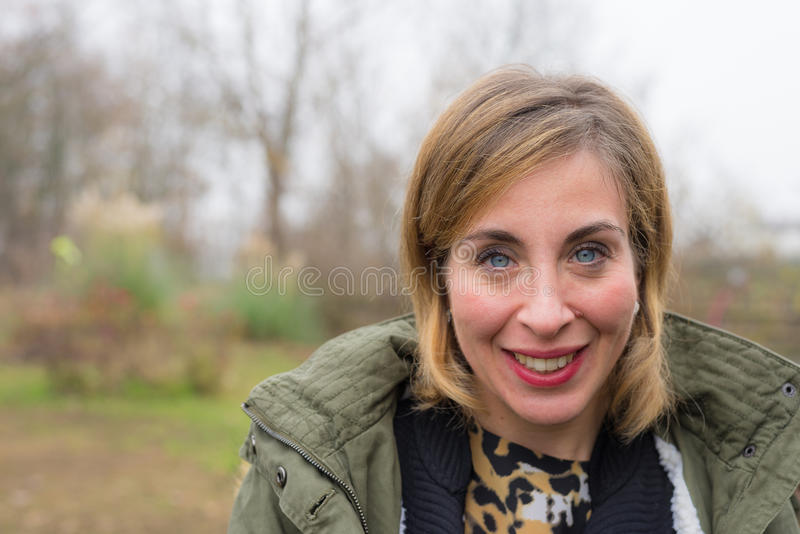 Portrait of smiling young woman, outdoors royalty free stock image