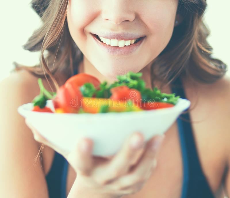 Portrait of smiling young woman with vegetarian vegetable salad royalty free stock images