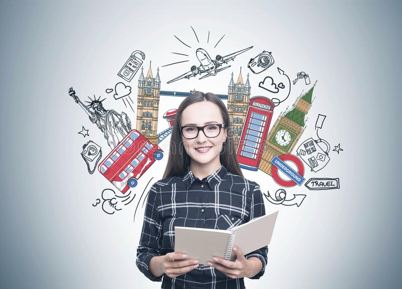 Smiling woman in glasses, copybook, travel stock image