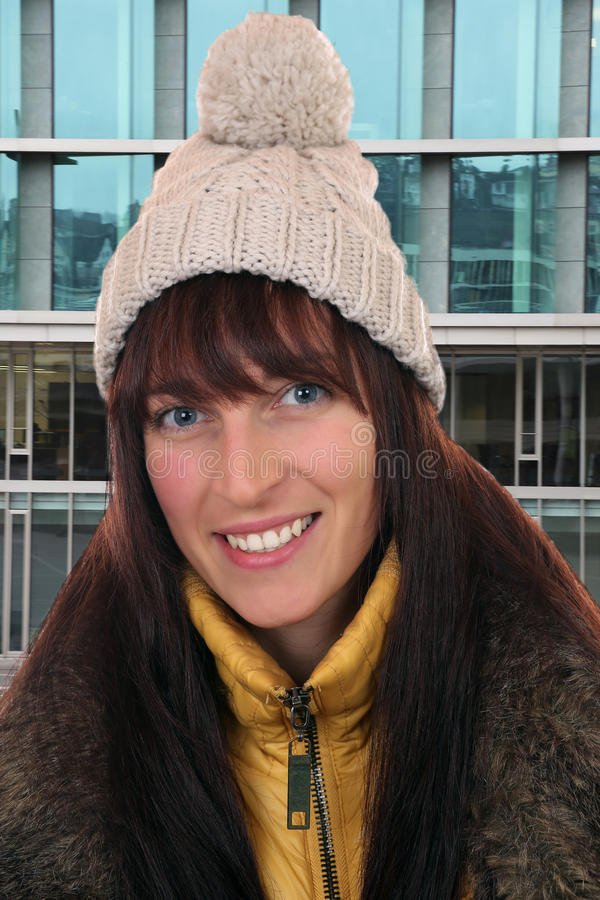 Portrait of smiling young woman in winter in town stock images