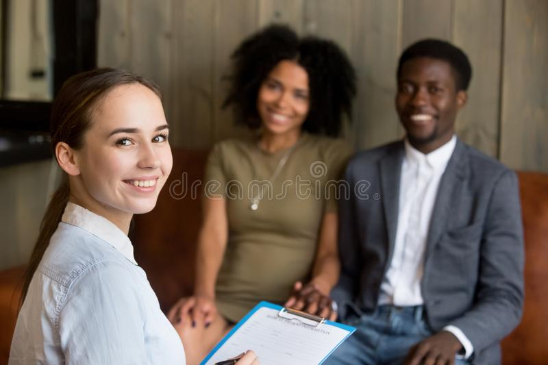 Portrait of smiling woman psychologist and happy african america. Portrait of smiling young women professional psychologist or counselor looking at camera with stock images