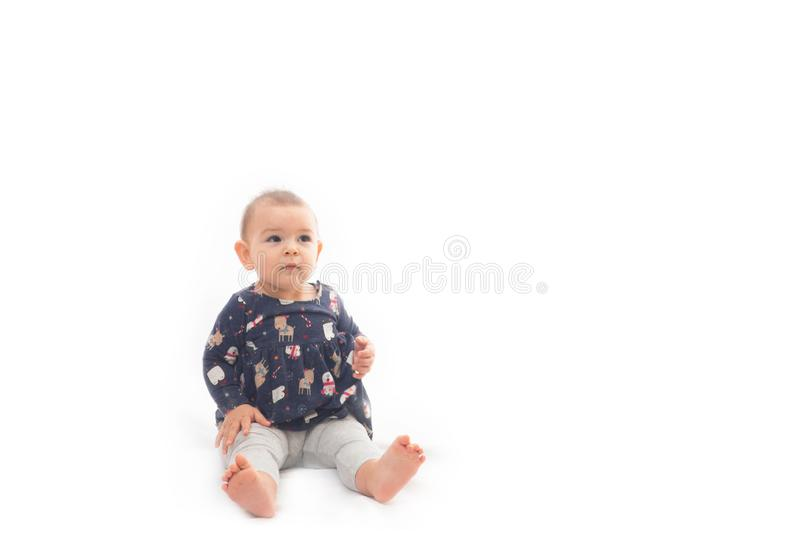 Portrait of a smilling baby girl smiling isolated on a white background childhood stock photos