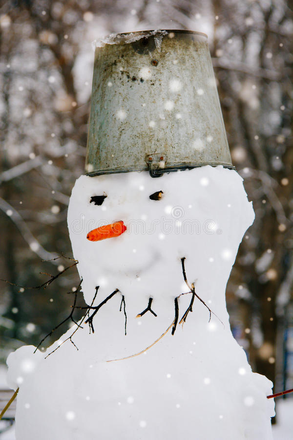 Download Portrait Of A Snowman In City Park Stock Photo - Image: 83719055
