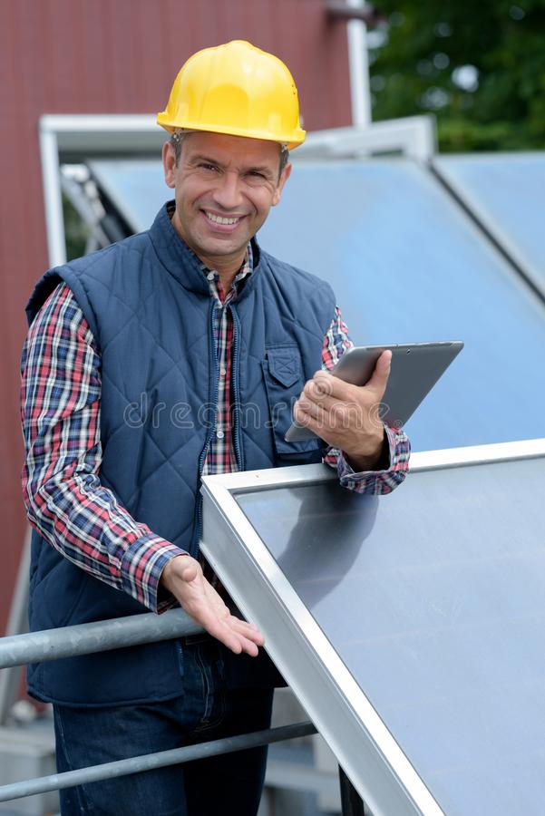 Portrait solar panel engineer holding tablet stock photo
