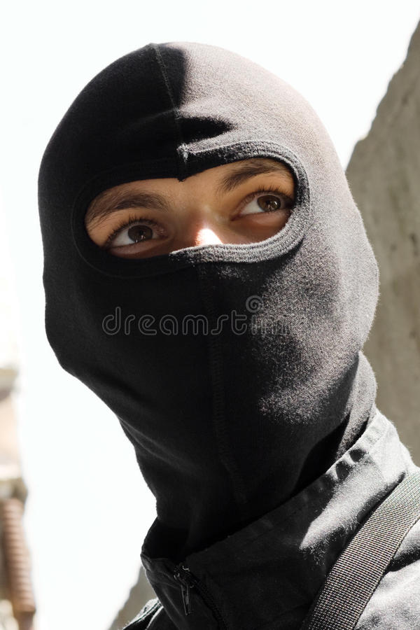 Portrait of a soldier in black mask royalty free stock photo