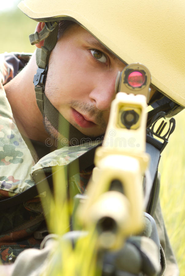 Portrait of soldier in helmet targeting stock image