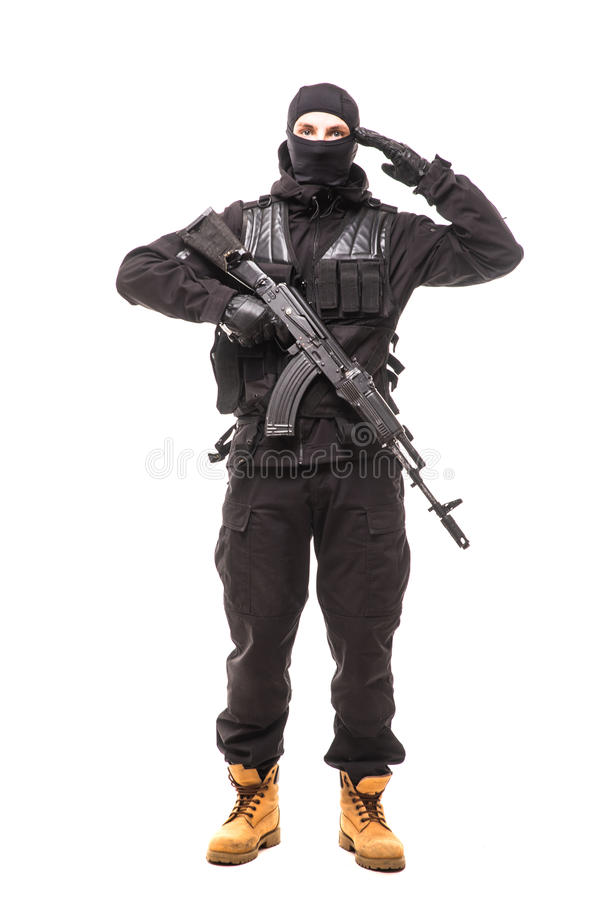 Portrait of soldier holding a rifle and saluting stock photos