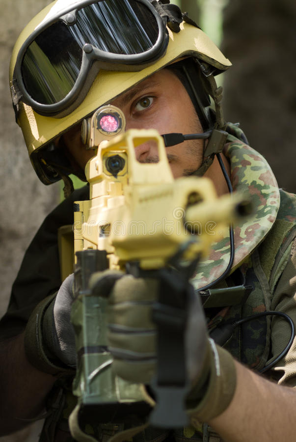 Portrait of a soldier targeting with a rifle royalty free stock image