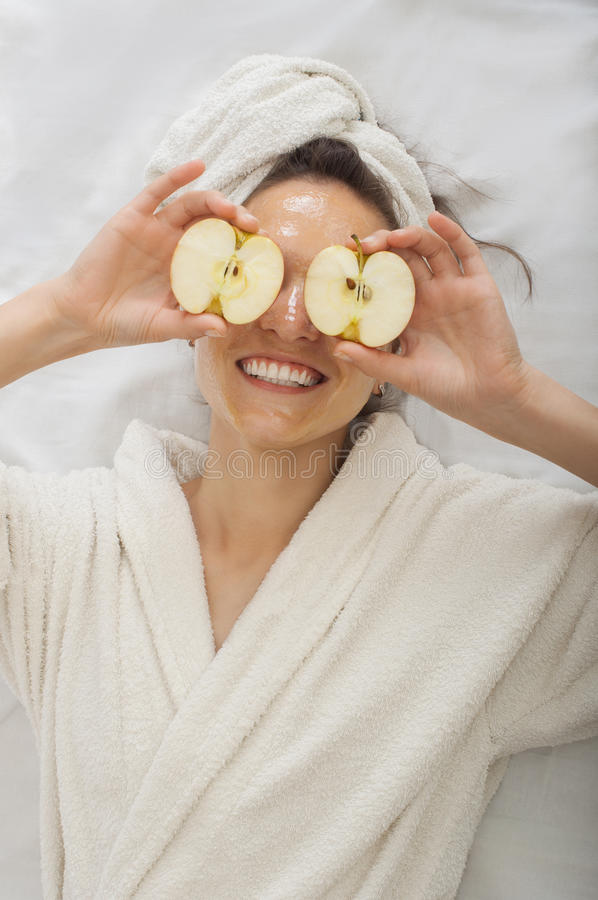 Portrait of a spa girl with Facial honey Mask royalty free stock photography