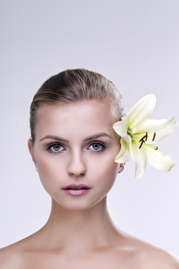 Portrait of spa woman with flower royalty free stock photos