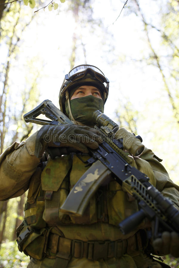 Portrait of special forces soldier. For operations in forest stock image
