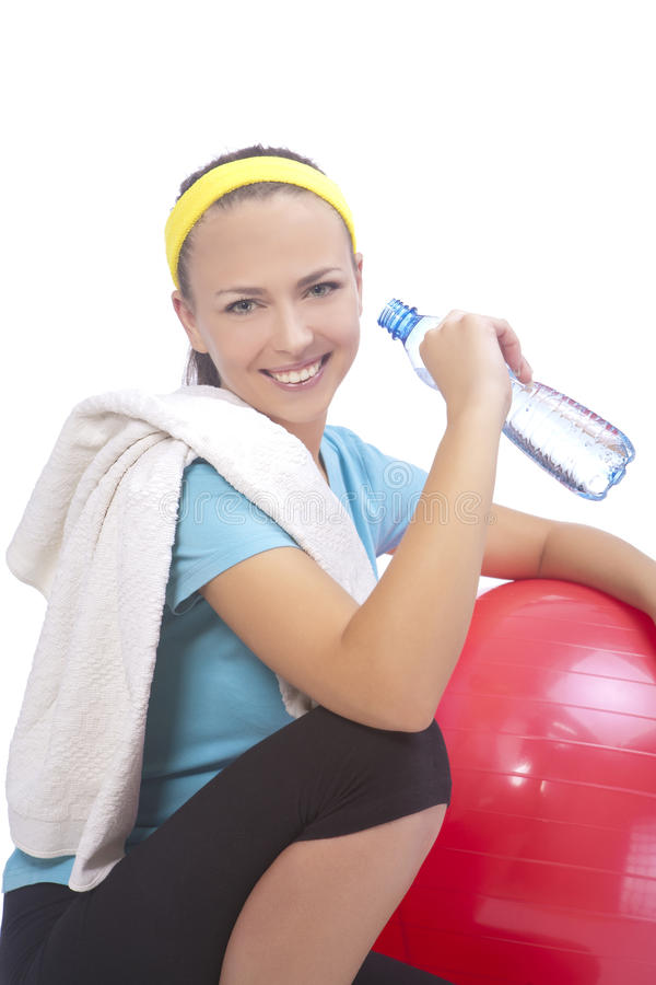 Portrait of sportswoman drinking water royalty free stock photography