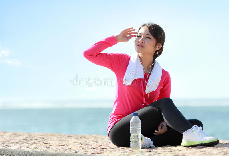 Portrait of sporty girl protect the face from sunburn. On the beach royalty free stock photos