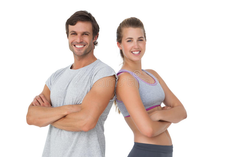 Portrait of a sporty young couple with arms crossed stock photo