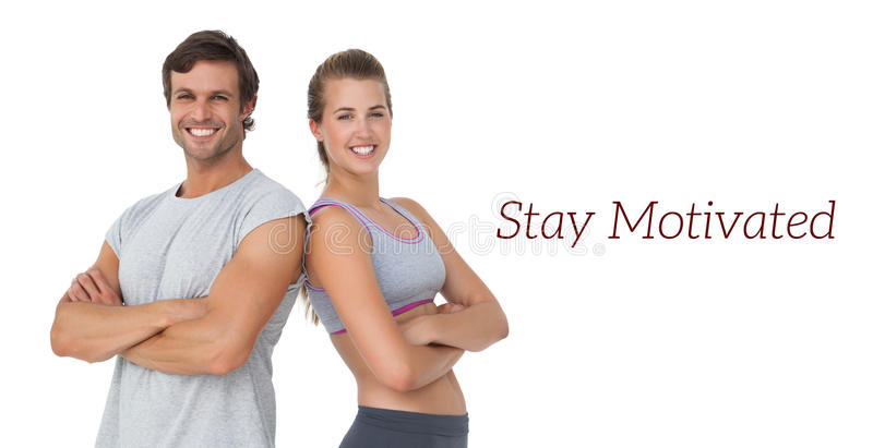 Portrait of a sporty young couple with arms crossed royalty free stock image