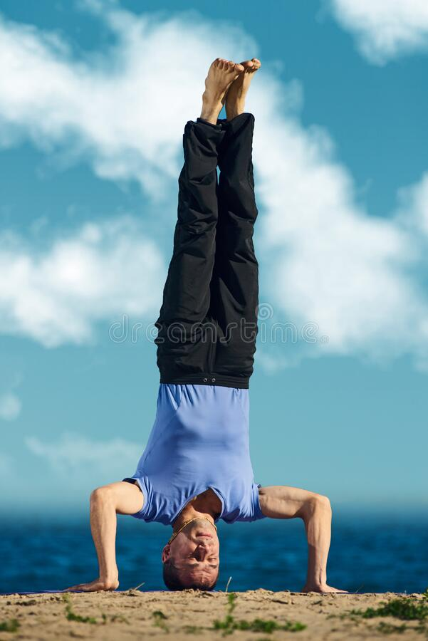 Sportsman doing headstand royalty free stock images