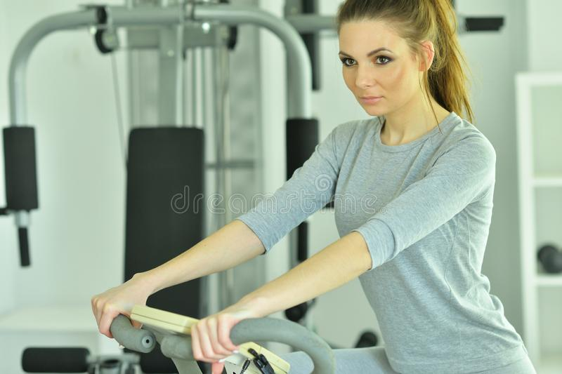 Portrait of young woman training in gym royalty free stock photo