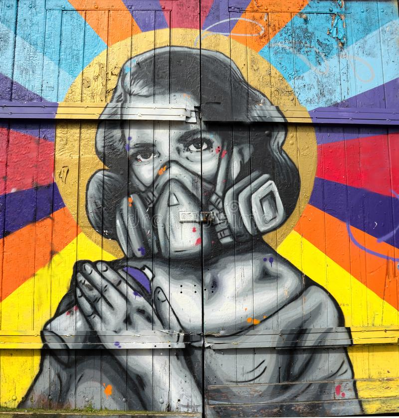 Portrait of a spray paint street artist with respirator. royalty free stock photo