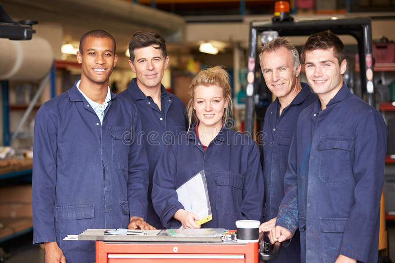 Portrait Of Staff Standing In Engineering Factory royalty free stock images