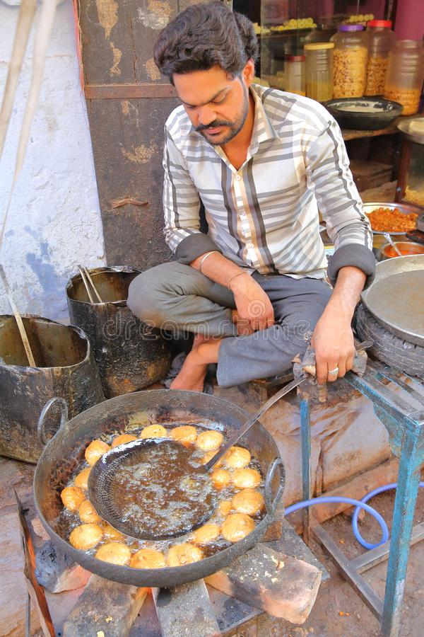 Portrait of a street vendor cooking and selling food inside the old city stock image
