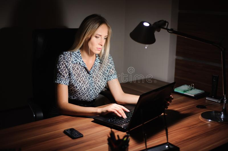Portrait of stressed businesswoman sitting at office desk royalty free stock photos