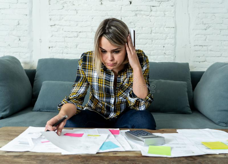 Portrait of stressed and overwhelmed young woman accounting home and business finances paying bills. Portrait of worried and desperate young woman in stress stock photos