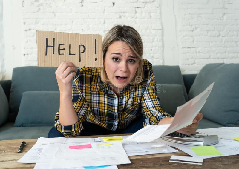 Portrait of stressed and overwhelmed young woman trying to manage home finances paying bills. Lifestyle portrait of worried desperate young woman feeling royalty free stock photos