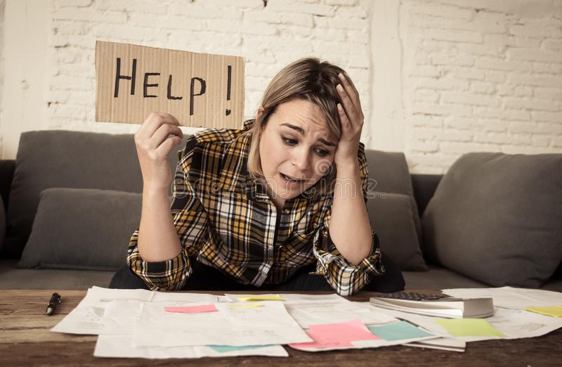Portrait of stressed and overwhelmed young woman trying to manage home finances paying bills. Lifestyle portrait of worried desperate young woman feeling stock images