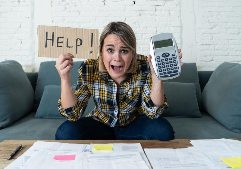 Portrait of stressed and overwhelmed young woman trying to manage home finances paying bills. Worried young woman feeling stressed while accounting business and royalty free stock images