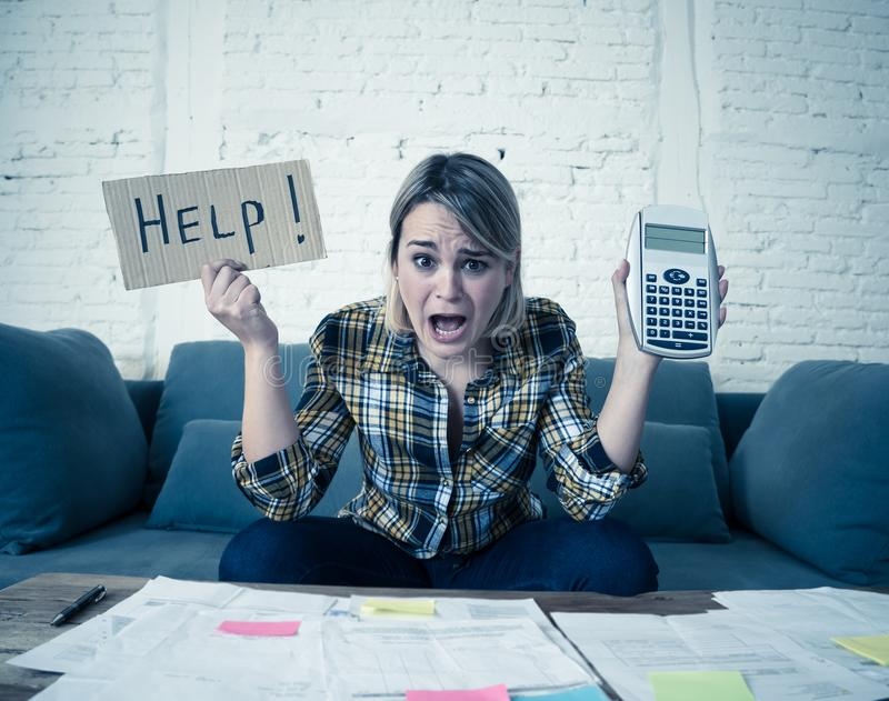 Portrait of stressed and overwhelmed young woman trying to manage home finances paying bills. Worried young woman feeling stressed while accounting business and royalty free stock image