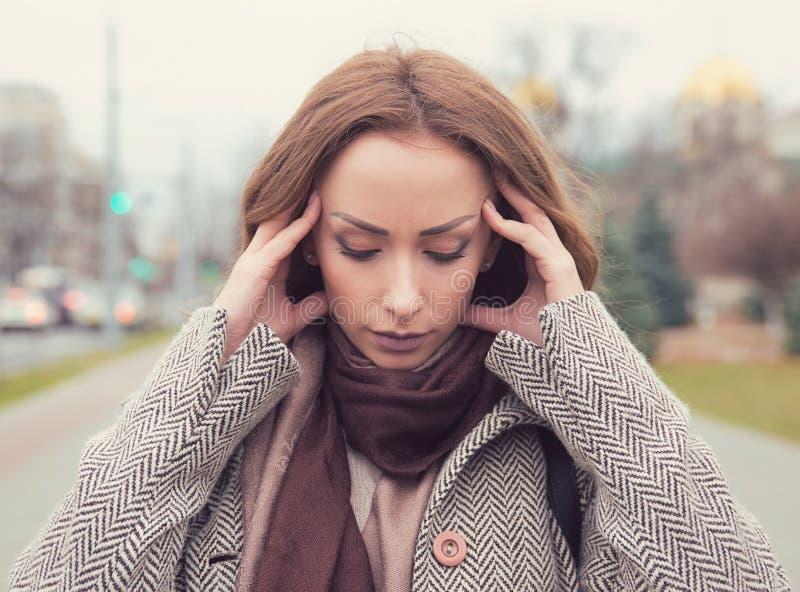 Portrait stressed sad woman outdoors. City urban life style stress. Portrait stressed sad young woman outdoors. City urban life style stress stock image