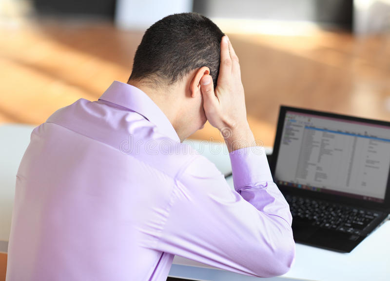 Portrait of stressful tired young businessman at work royalty free stock photography