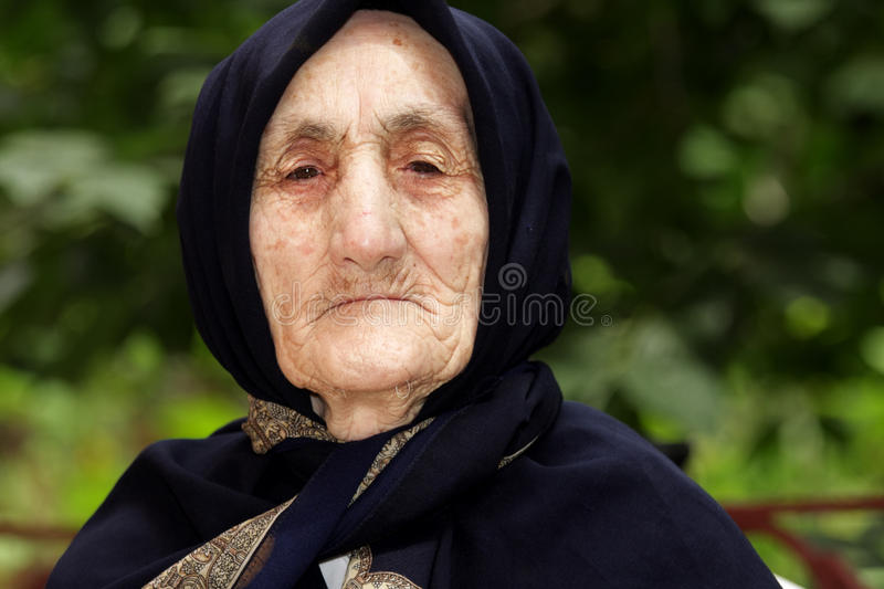 Portrait of strict elderly woman royalty free stock photography