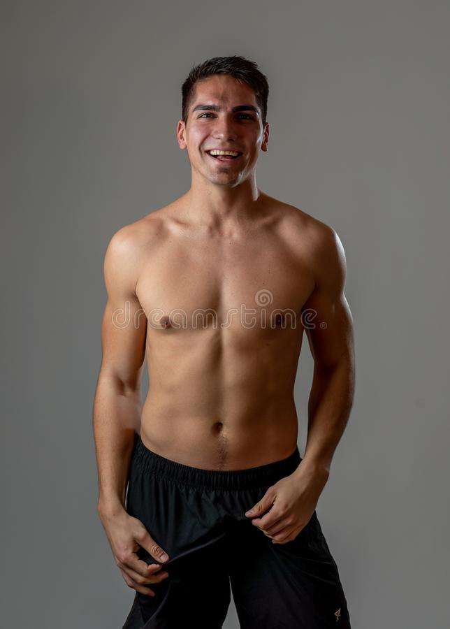Portrait of strong healthy handsome Athletic man isolated on neutral background royalty free stock photo