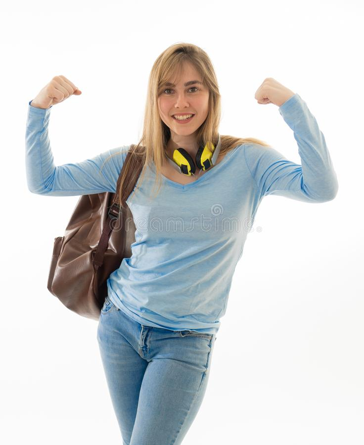 Portrait of strong and proud teenager student girl posing joyful showing arms in winning position royalty free stock photography