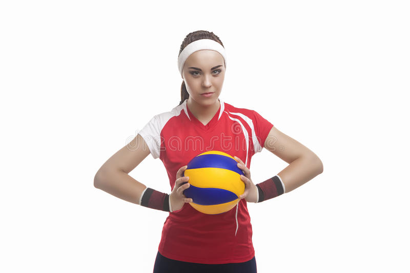 Portrait of Strong Willed Caucasian Professional Female Volleyball Player Equipped in Volleyball Outfit Holding Ball stock photos