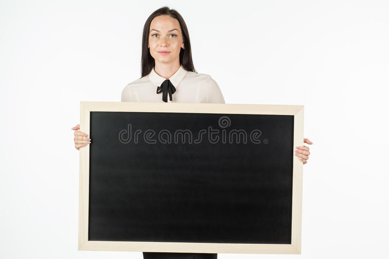Portrait of a student, girl, holding a blank billboard. stock images