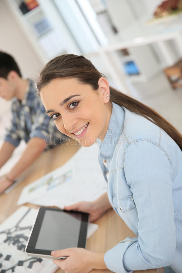 Portrait of student girl using digital tablet stock photos