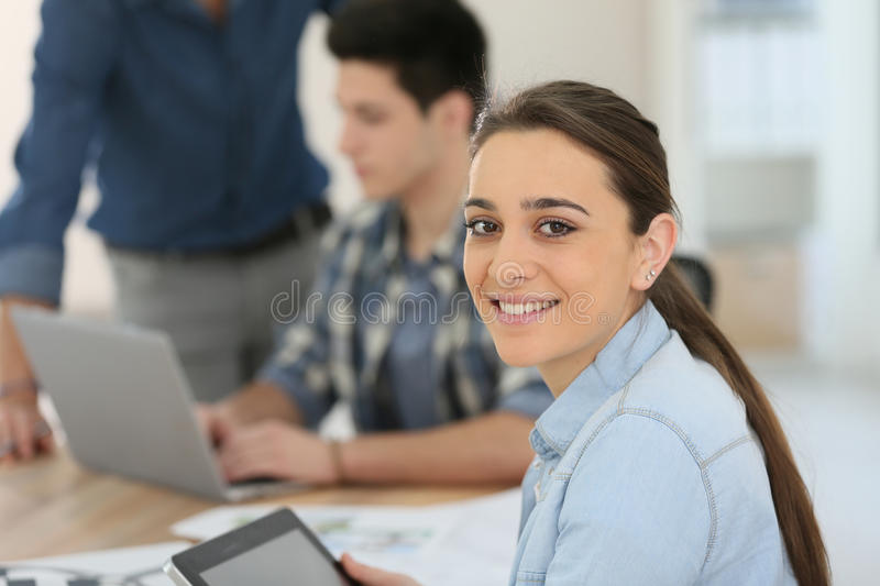 Portrait of student girl using digital tablet royalty free stock image