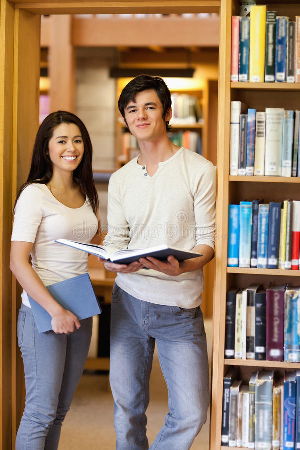 Download Portrait Of Students Holding Books Stock Image - Image: 21145579