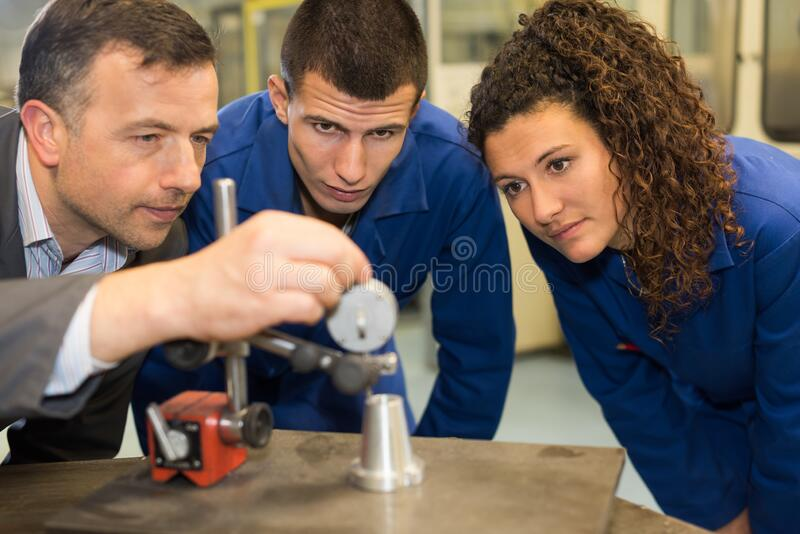 Portrait students watching engineering experiment royalty free stock photos