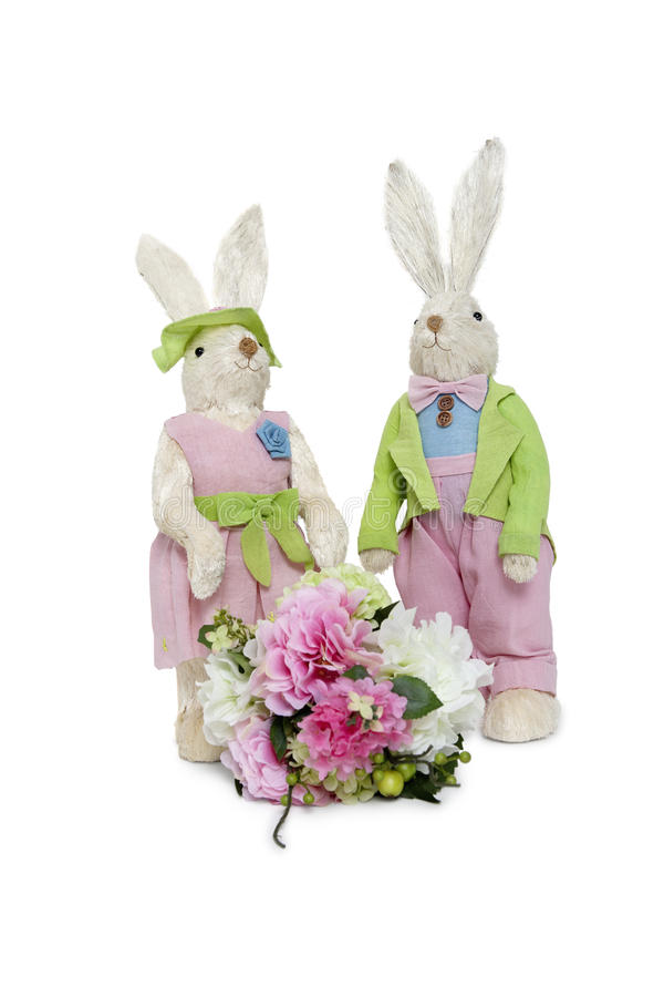 Download Portrait Of Stuffed Rabbit Couple Standing Together With Flower Bouquet Over White Background Stock Photo - Image: 29674044