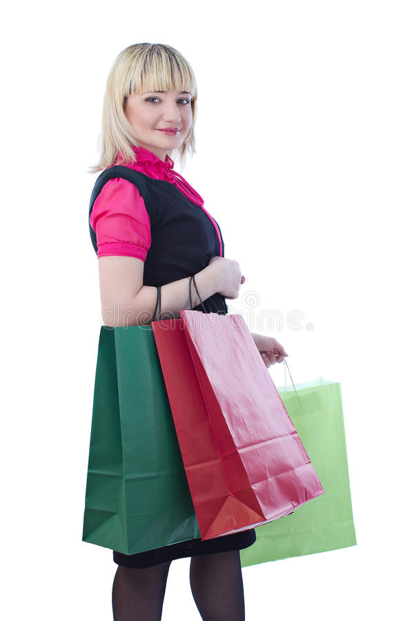 Portrait of stunning woman holding shopping bags stock images