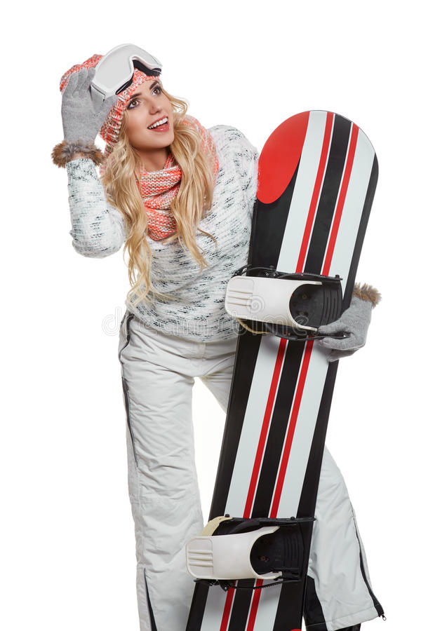 Portrait of a styled professional model with snowboard. royalty free stock images