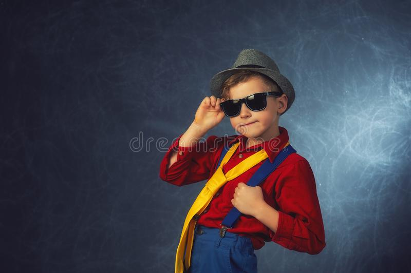 Portrait of a fashionable boy in the Studio royalty free stock photos