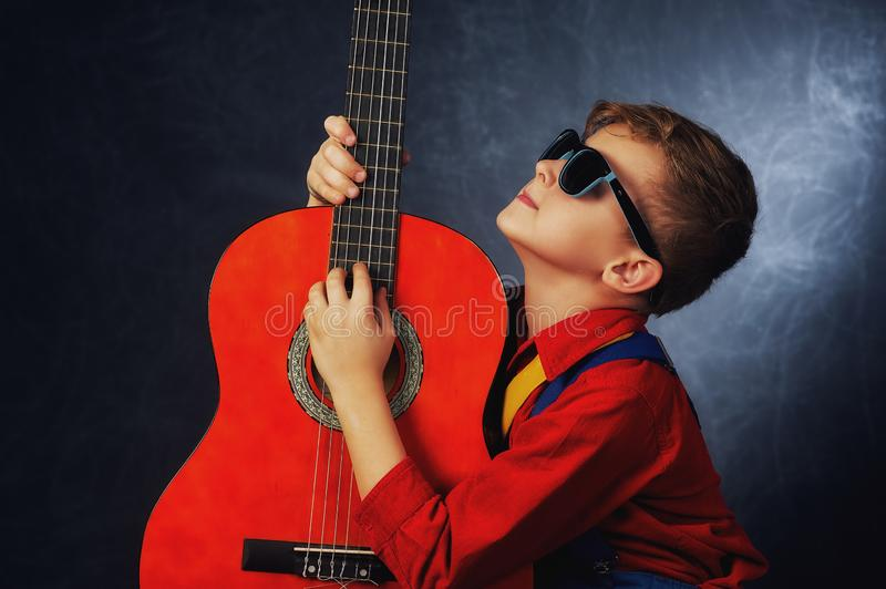 Portrait of a fashionable boy in the Studio royalty free stock photography