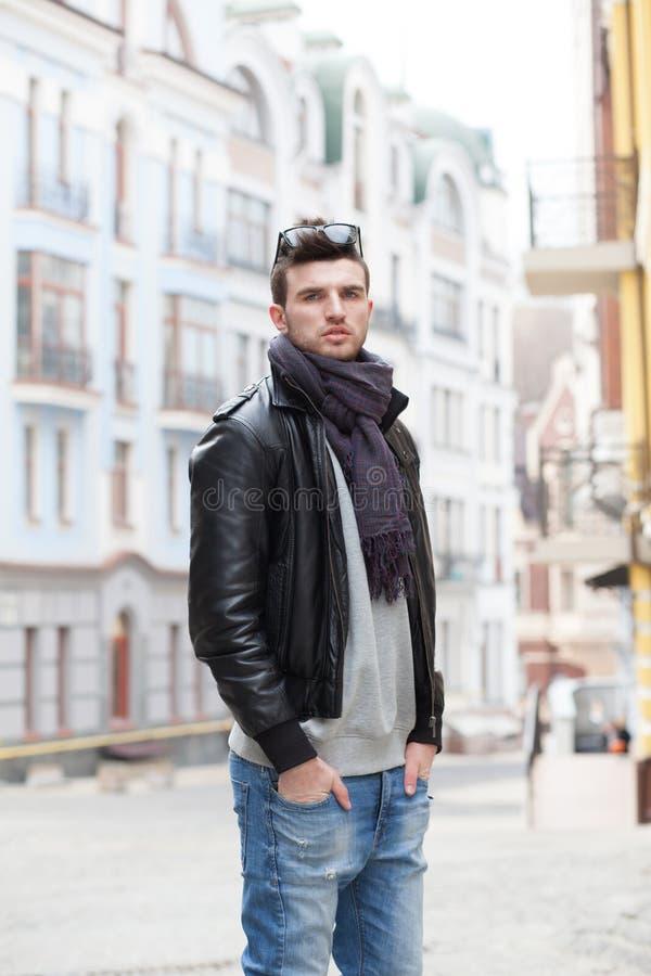 Portrait of stylish guy outdoors stock photo
