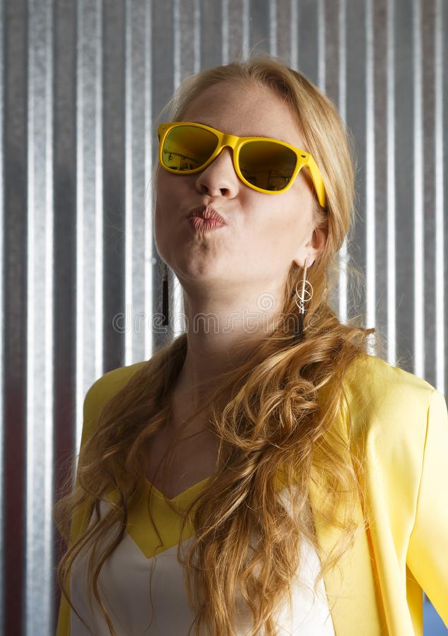 Portrait of stylish happy feminine woman making kiss grimace royalty free stock photography
